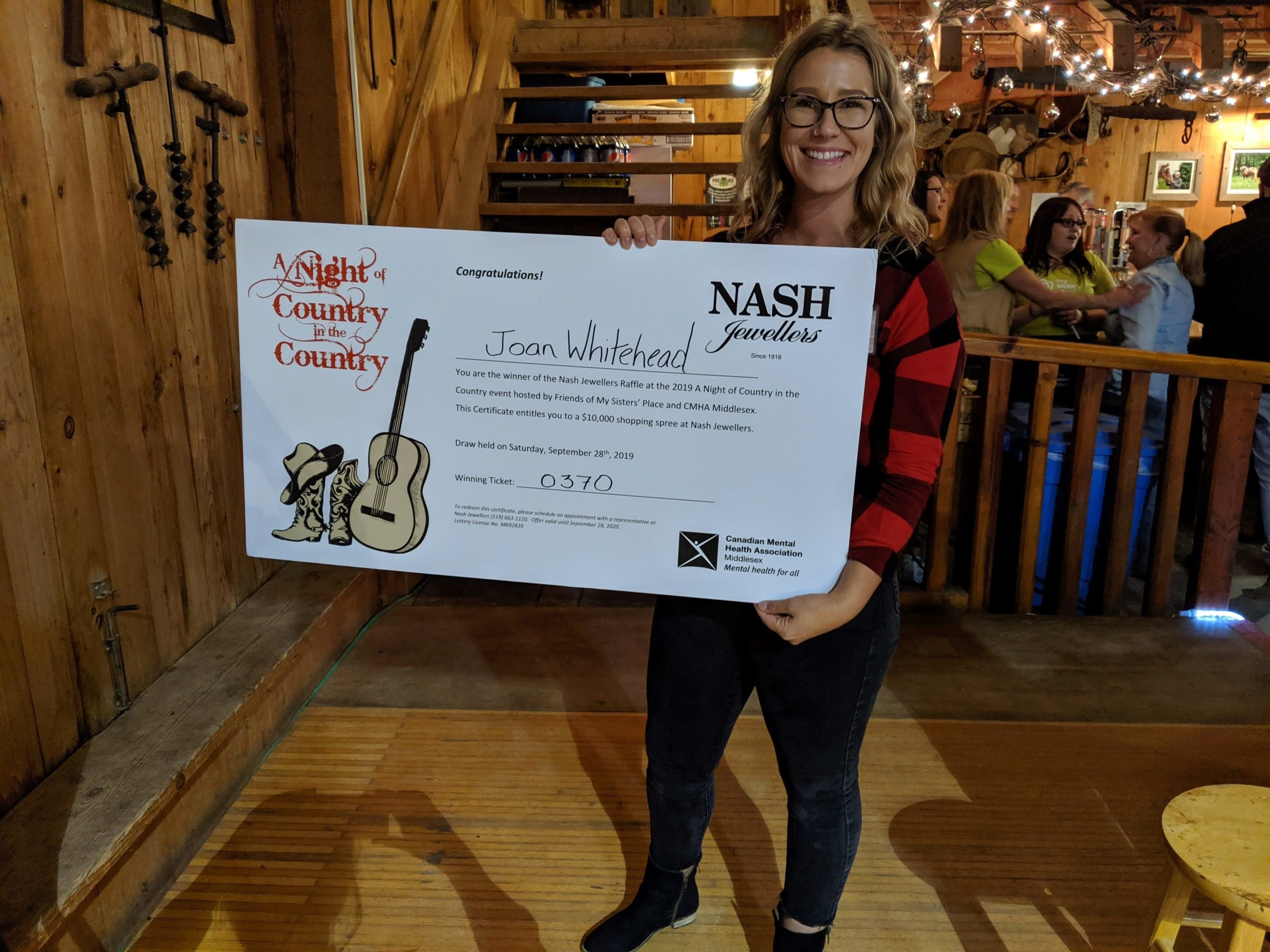 Moria Byrne accepting $10,000 Nash Jewellers Shopping Spree on behalf of winner, Joan Whitehead