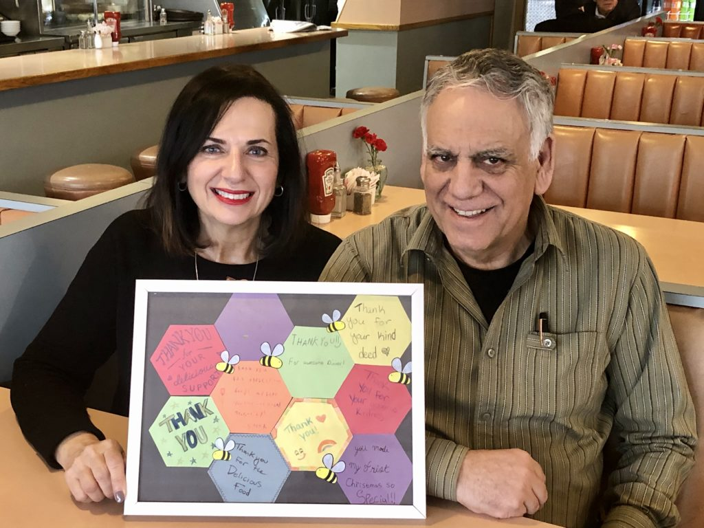 Pictured: Gus and Athena Economopoulos with a beautifully handmade thank you from the participants.